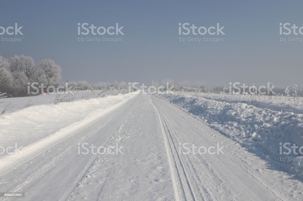 Snow covered country road stock photo