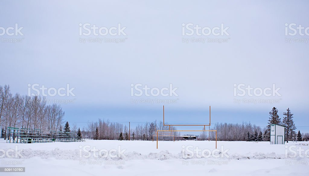 Snow covered football field stock photo