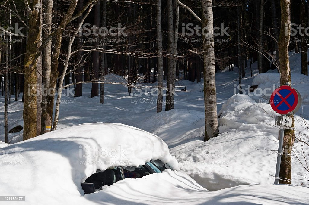 Snow covered forgotten car stock photo