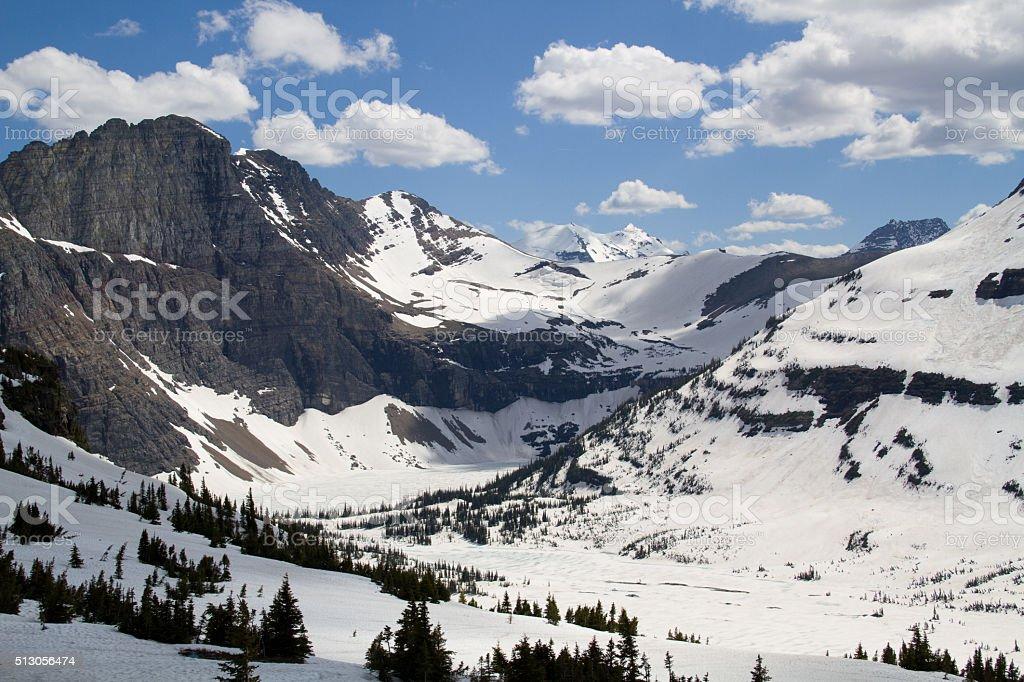 Snow Covered hidden Lake in Glacier National Park stock photo