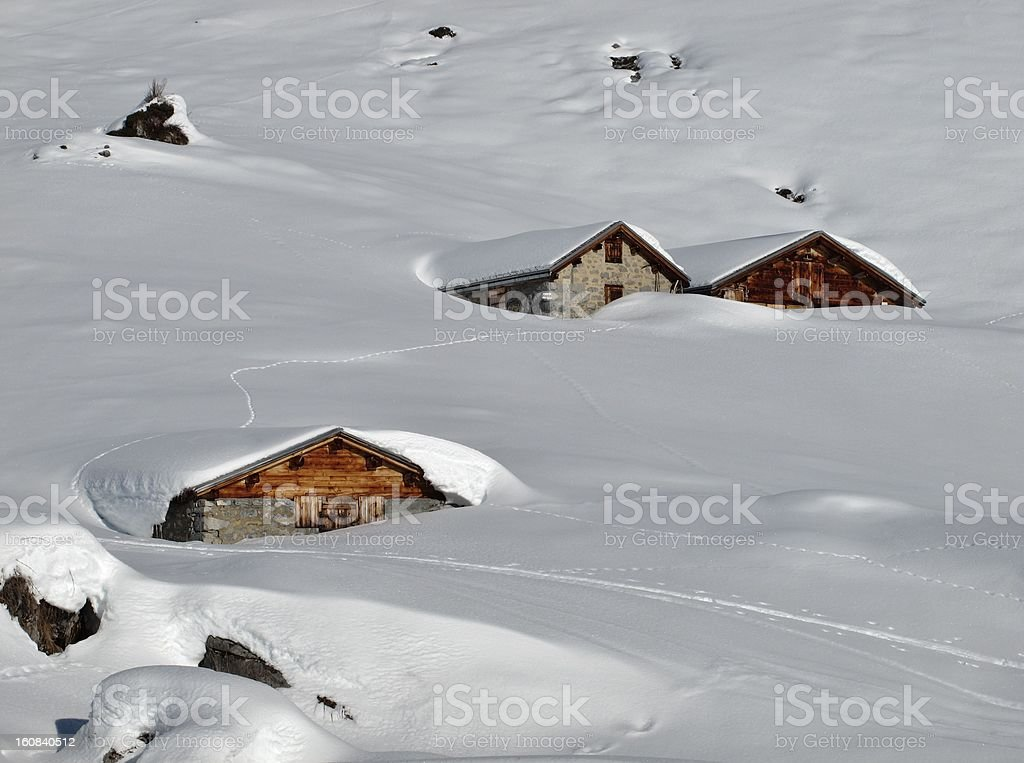 Snow covered huts stock photo