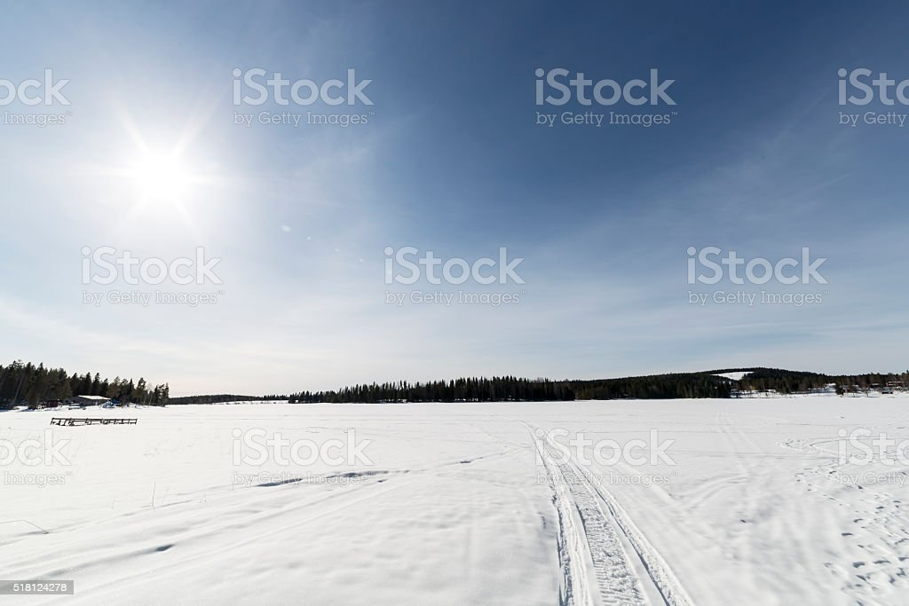 Snow Covered Lake in Sweden stock photo