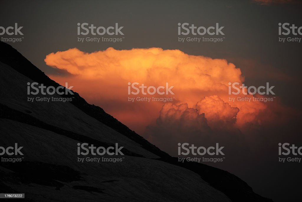 Snow covered Mountain and Clouds formation at sunset royalty-free stock photo
