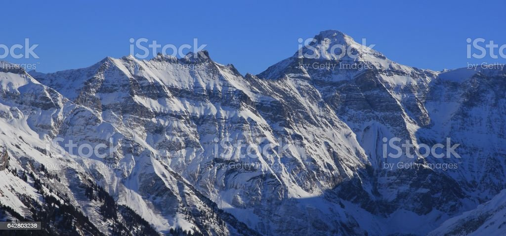 Snow covered mountain Hausstock, view from Braunwald stock photo