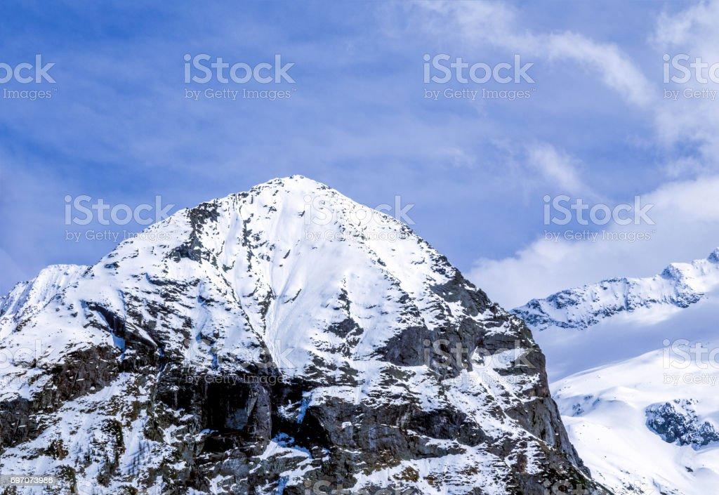 Snow covered mountain peak stock photo