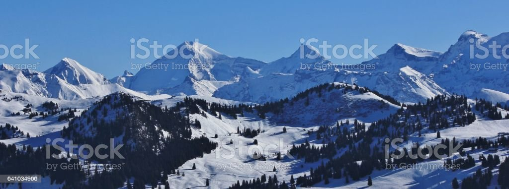 Snow covered mountain range in the Bernese Oberland stock photo