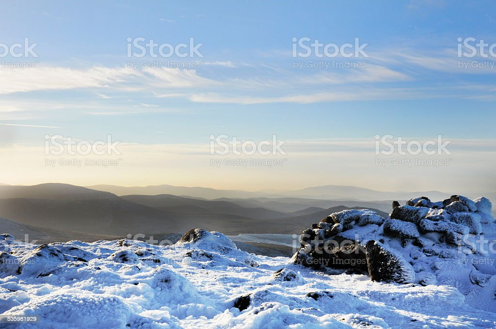 Snow covered Mountain summit stock photo