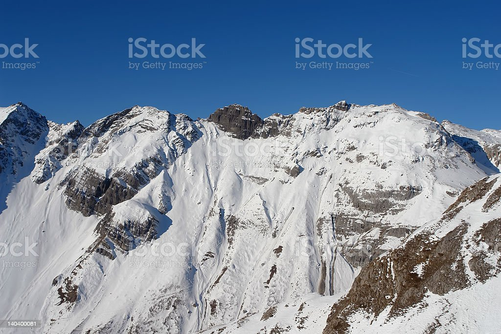 Snow covered mountain top in the Swiss Alps royalty-free stock photo
