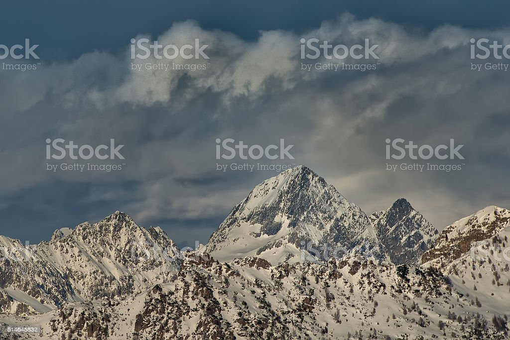 Snow covered mountain top. stock photo