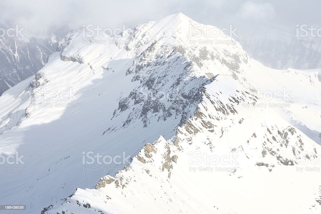 Snow covered mountain under thick cloud royalty-free stock photo
