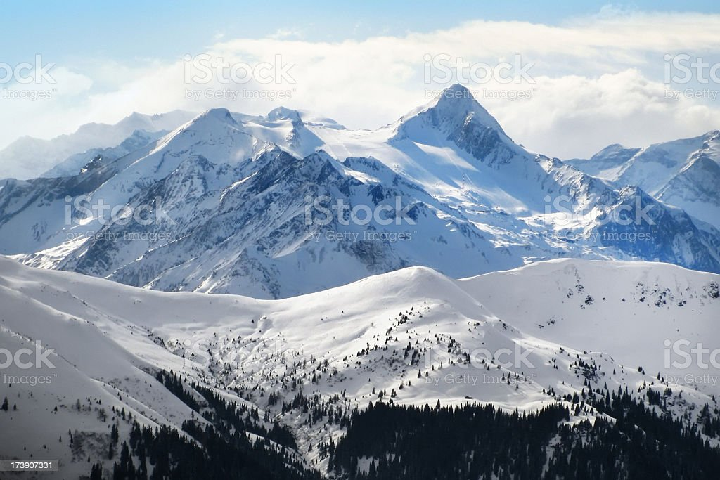 Snow covered mountains in the bright sunlight stock photo