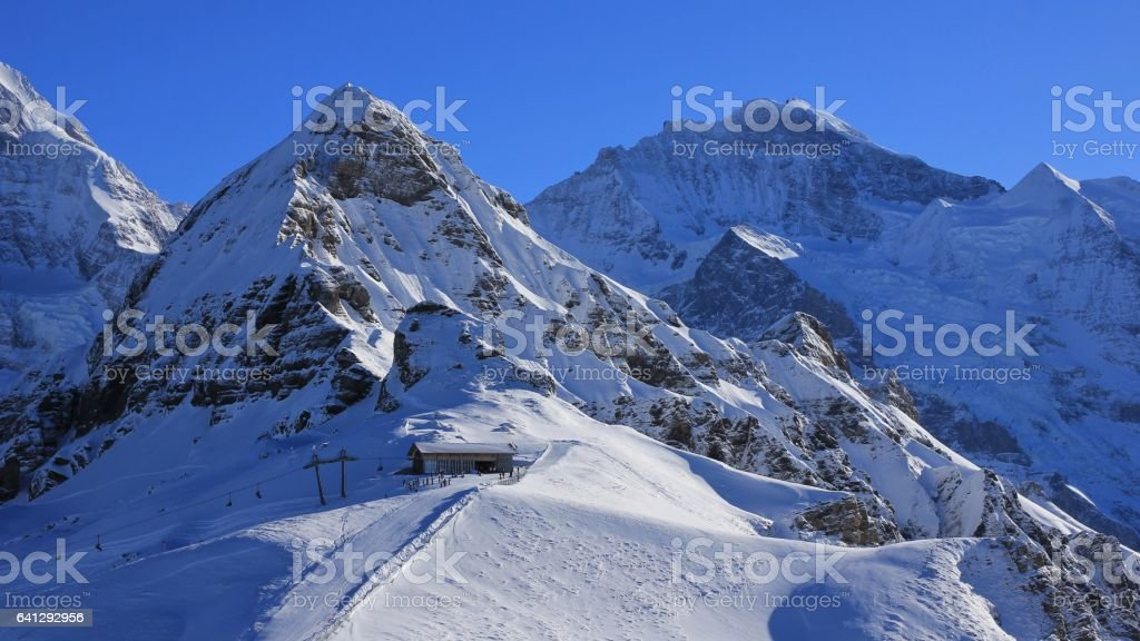 Snow covered mountains Lauberhorn and Jungfrau, summit station of a cable car stock photo