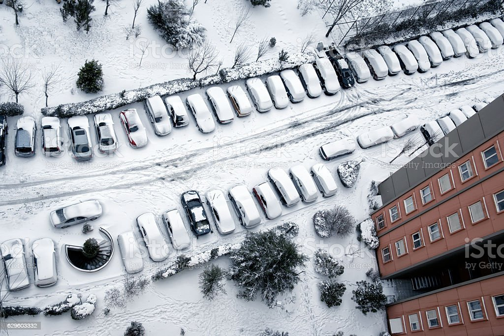 snow covered parking lot stock photo