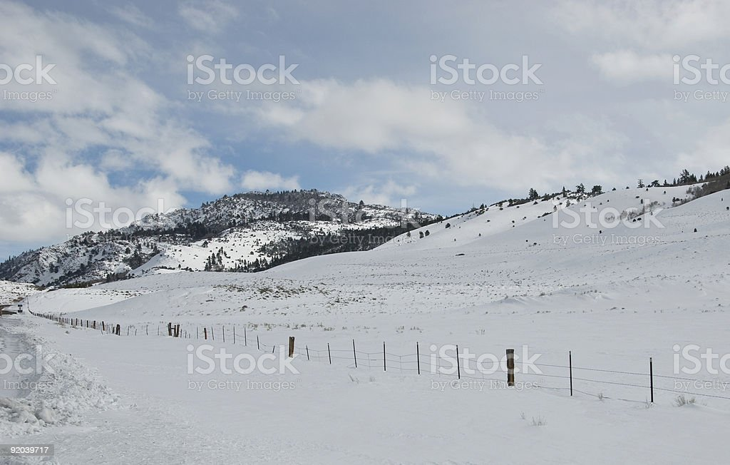 Snow Covered Pass with Fence Line stock photo