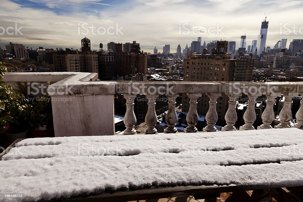 Snow Covered Picnic Table and New-York Skyline royalty-free stock photo
