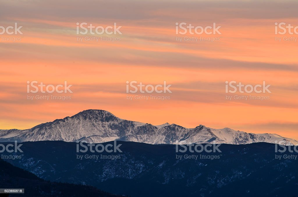 Snow Covered Pikes Peak at Sunset stock photo