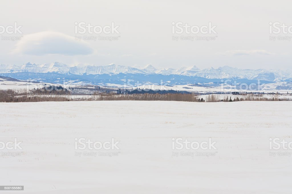 Snow Covered Praire and Footihils stock photo