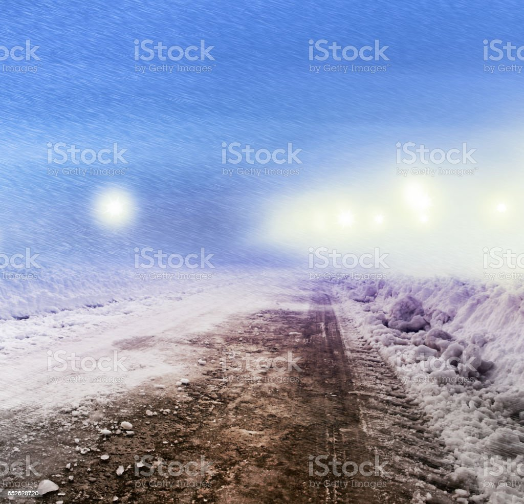 Snow covered road at night stock photo