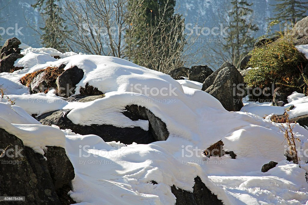 Snow Covered Rocks of Himalayan Mountain Ranges stock photo