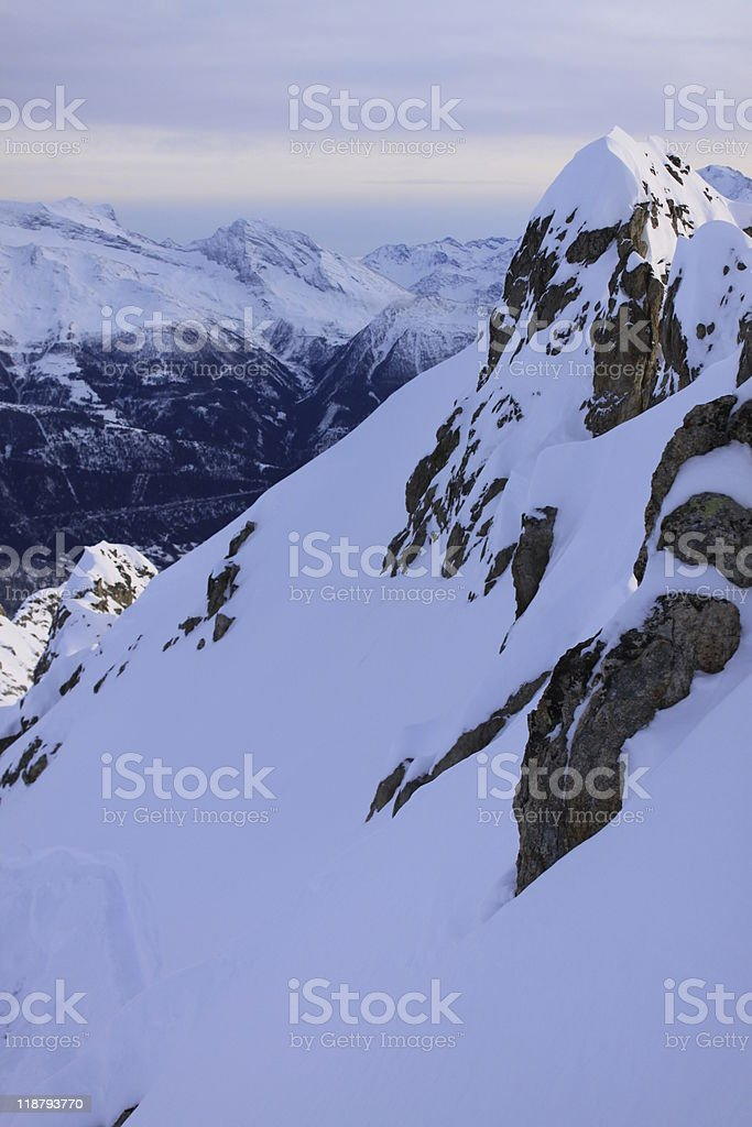 snow covered rocks stock photo