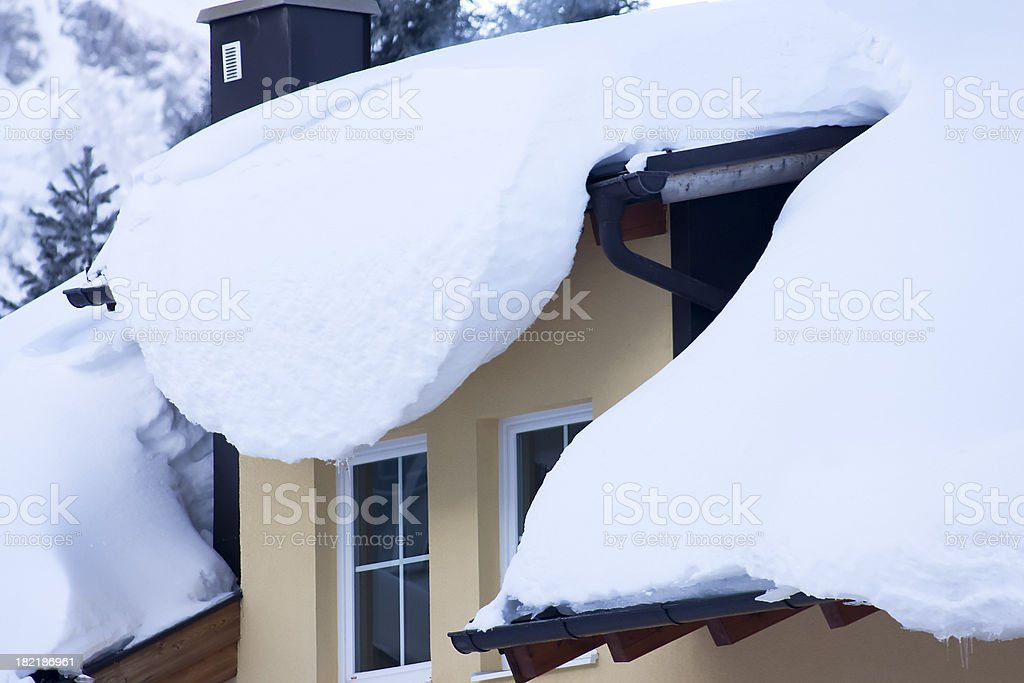 Snow covered roof and window stock photo