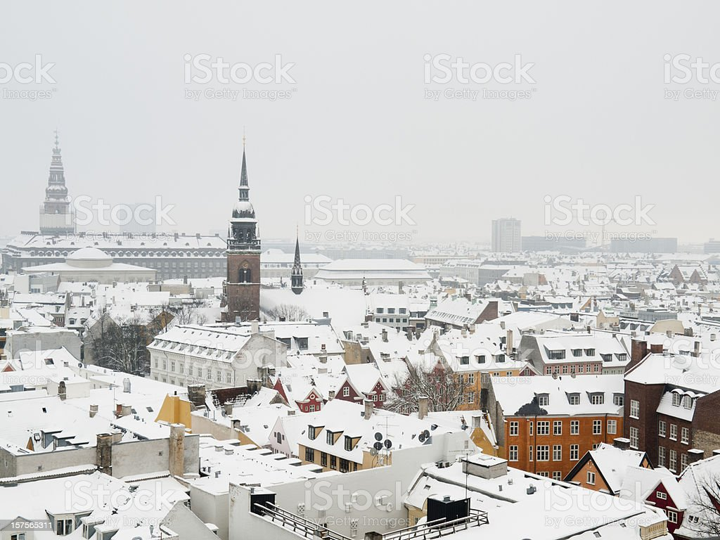Snow covered rooftops in Copenhagen stock photo