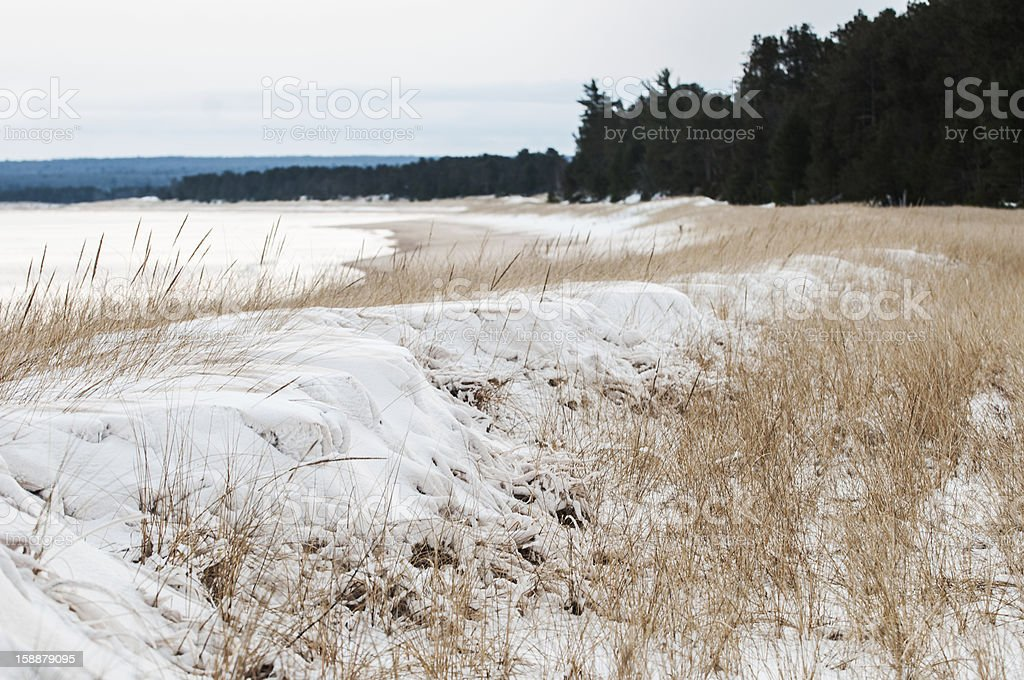 Snow covered shore line stock photo