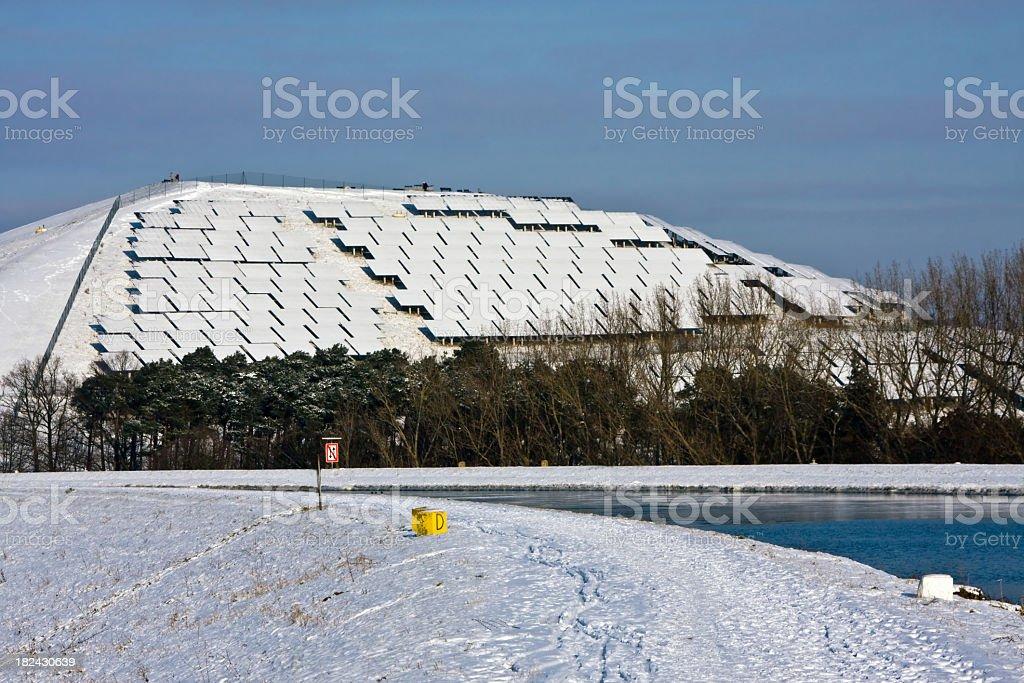 snow covered solar panels stock photo