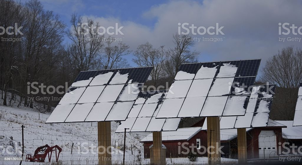 snow covered solar panels stock photo