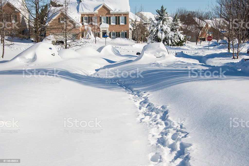 Snow covered street after a recent blizzard stock photo