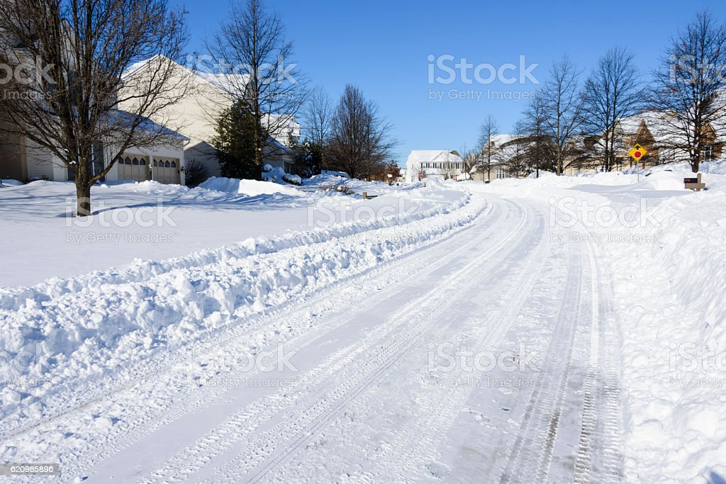 Snow covered street after recent plowing stock photo