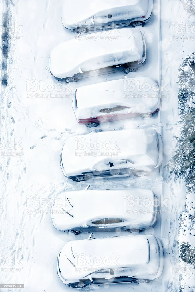 snow covered street and parking lot stock photo