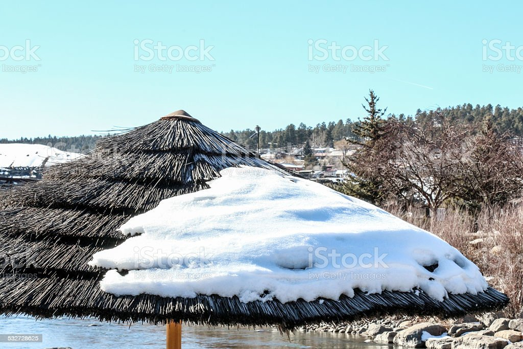Snow Covered Thatched Umbrella stock photo