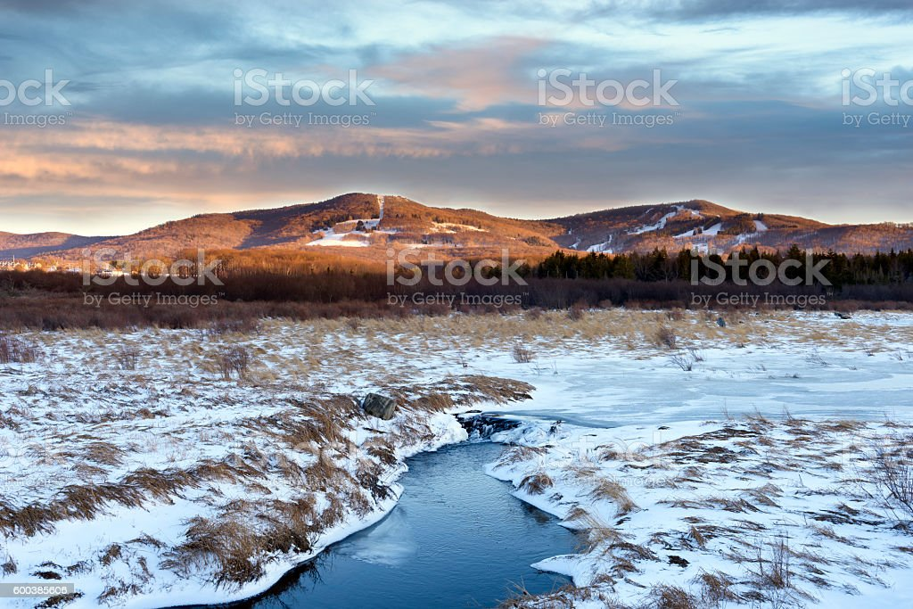 Snow Covered Valley and Mountain Ski Trails stock photo