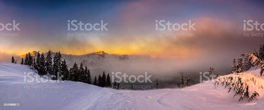 Snow covered view of Crater Lake NP Panorama stock photo