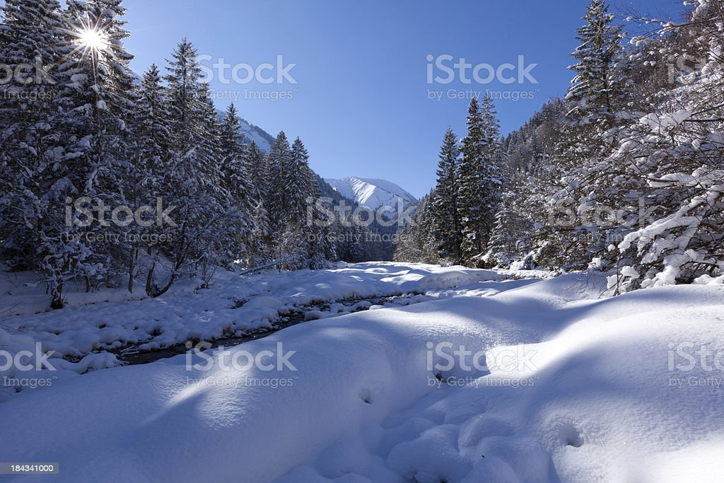 snow covered winter landscape in tirol with river, austria royalty-free stock photo