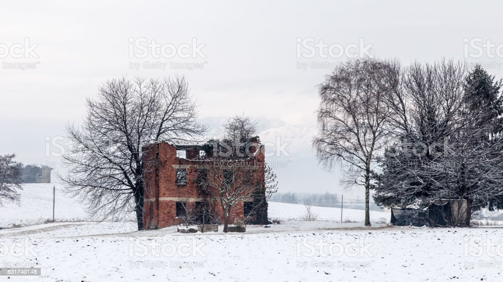 snow covering an abandoned farm stock photo