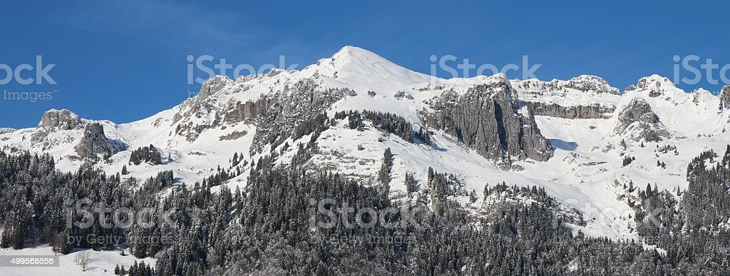 Snow cowered mountains in the Toggenburg valley stock photo