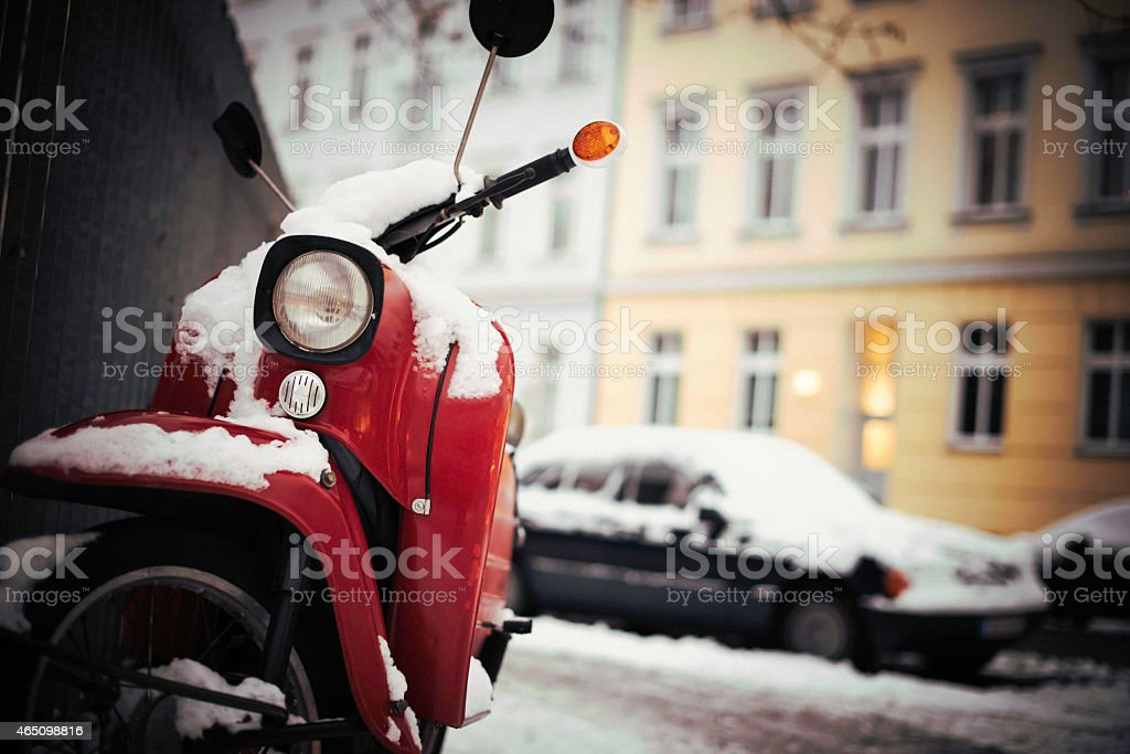 snow cropped moped in berlin stock photo