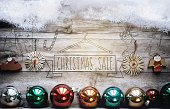 snow cropped wooden planks with christmas sale embossing and balls