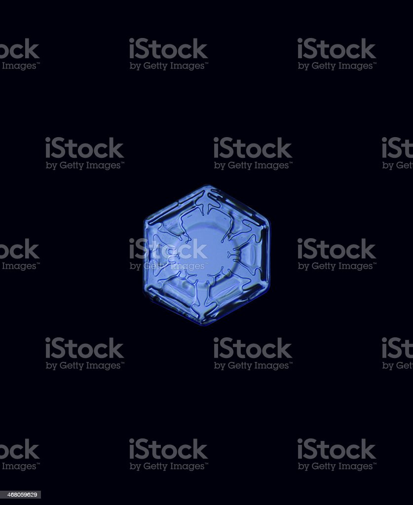 Snow crystal in black background stock photo