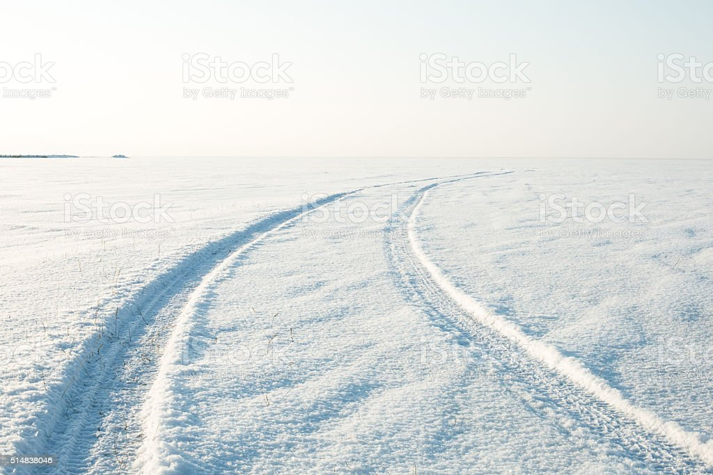snow desert and the tracks of the car in snow stock photo