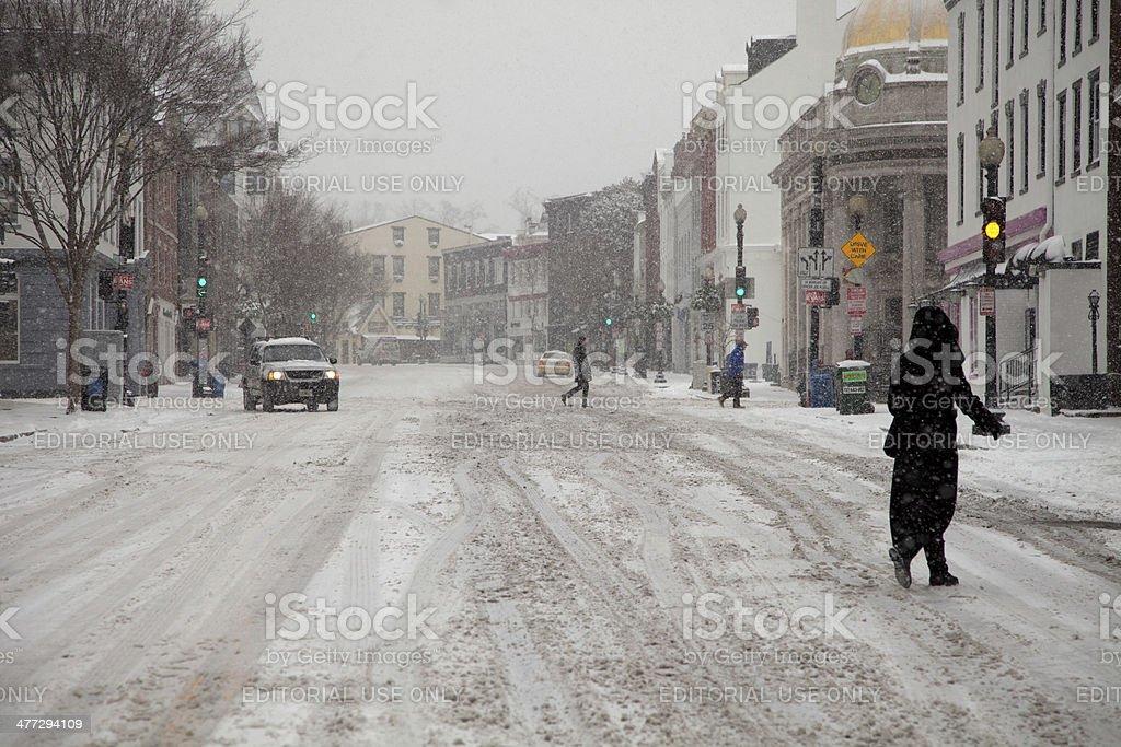 Snow driving slowly stock photo