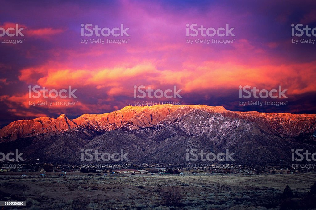 Snow Dusted Sandia Mountains at Magic Hour stock photo