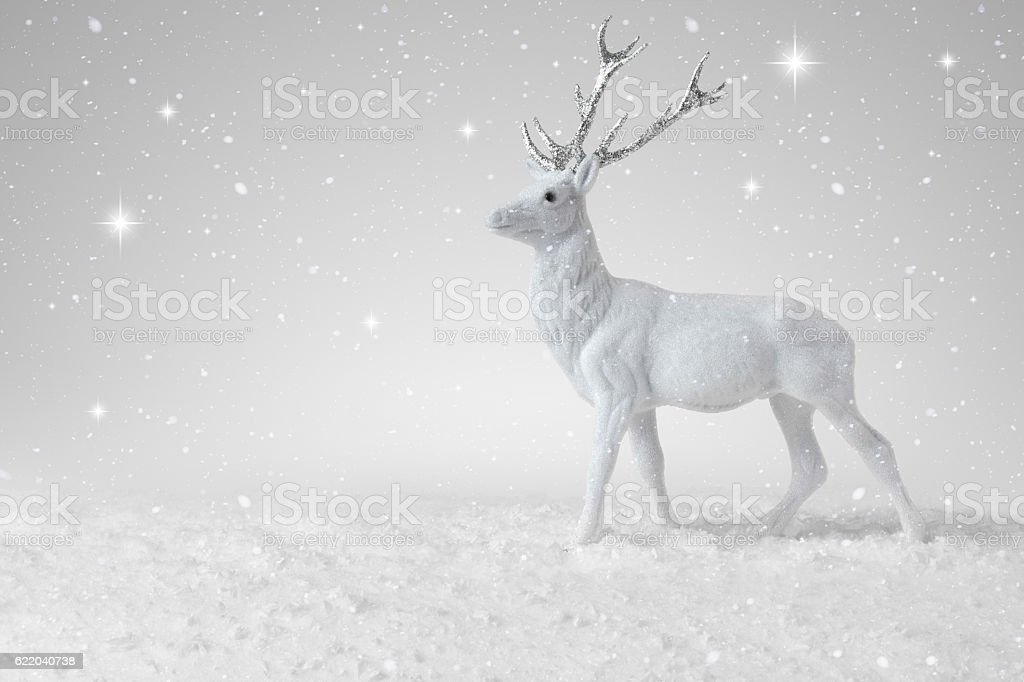 Snow falling on a Christmas Reindeer stock photo