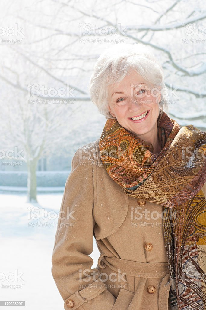 Snow falling on smiling woman royalty-free stock photo