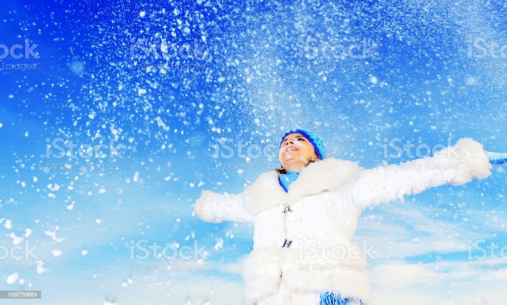 Snow falls and woman enjoys outdoor. royalty-free stock photo