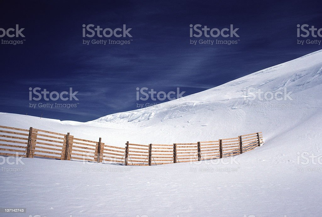 Snow Fence, Blue Sky, Swiss Alps stock photo