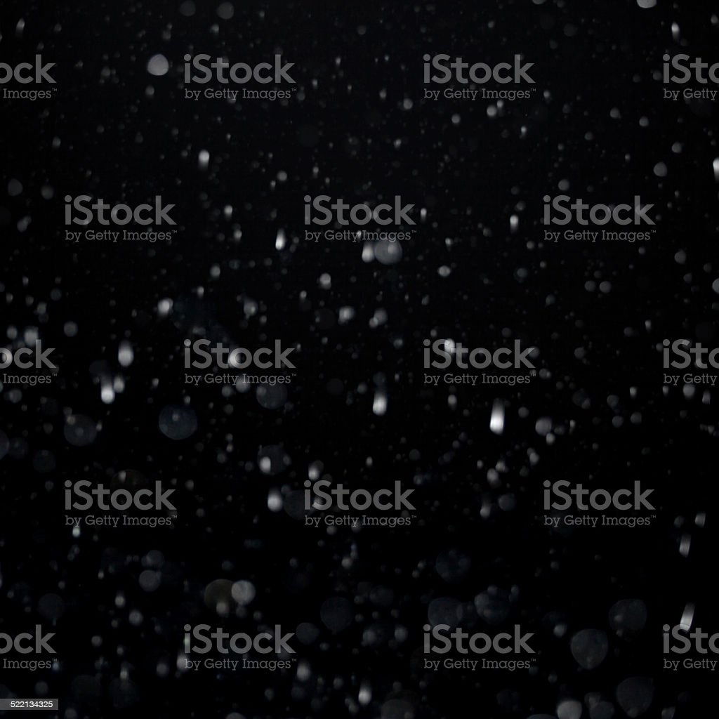 Snow flakes isolated on black background stock photo