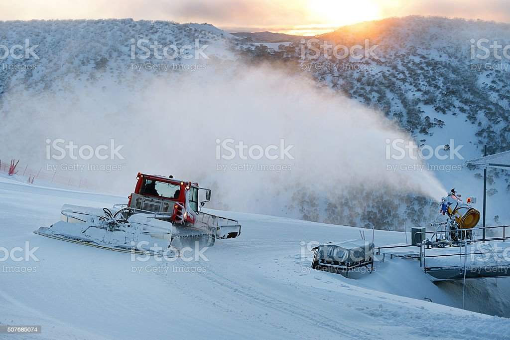 Snow Groomer and Snowmaking at Dawn stock photo